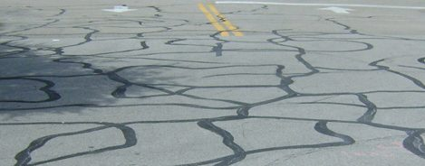 faded road and cracks