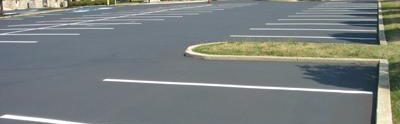Our Lady of Angels parking lot with fresh white paint lines