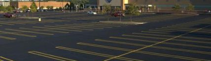 Sam's Club parking lot with new black pavement
