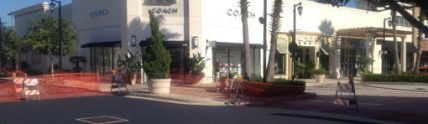 new pavement in front Coach store at shopping center