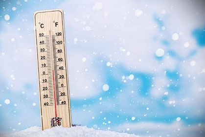 thermometer sitting in snow