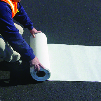 gentleman unrolling white thermoplastic tape